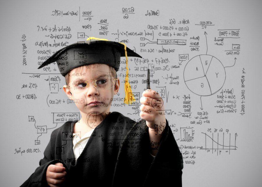 Child in graduate uniform writing some formulas
