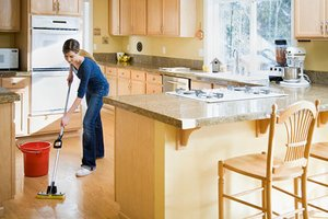 woman-cleaning-kitchen-floor