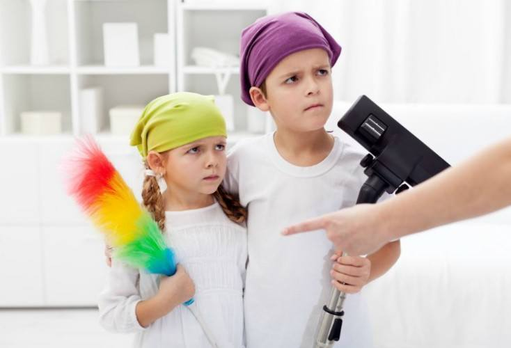 Kids forced to clean their room, parent hand pointing